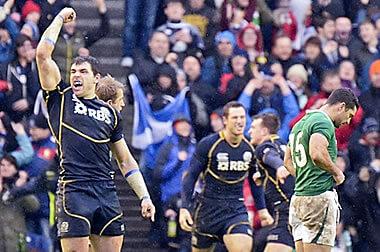 Scotland's backs celebrate victory over Ireland - © Alastair Ross