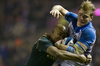 David Denton is tackled by JP Pietersen - pic © Al Ross