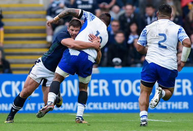 Ross Ford tackles a Samoan - pic © Al Ross