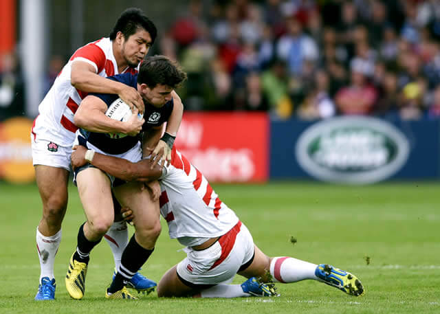 Matt Scott battles through Japanese tacklers - pic © Al Ross/Novantae Photography