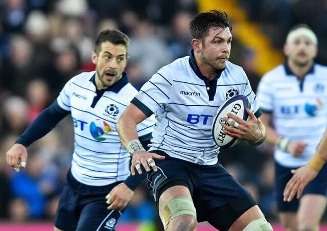 Greig Laidlaw watches as Ryan Wilson prepares for contact pic © Al Ross/Novantae Photography
